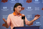 Oklahoma State head coach Mike Gundy answers questions during an NCAA college football news conference Thursday, Aug. 26, 2021, in Stillwater, Okla. (AP Photo/Sue Ogrocki)