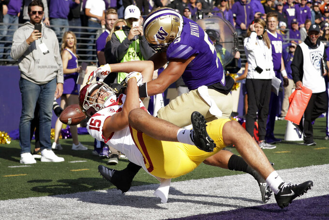 Southern Cal's Drake London (15) tumbles backward out of the end zone after missing a pass as Washington's Myles Bryant defends in the second half of an NCAA college football game Saturday, Sept. 28, 2019, in Seattle. Washington won 28-14. (AP Photo/Elaine Thompson)