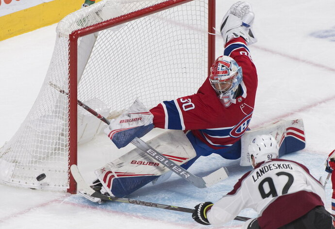 Montreal Canadiens goaltender Cayden Primeau makes a save against Colorado Avalanche's Gabriel Landeskog during the second period of an NHL hockey game Thursday, Dec. 5, 2019, in Montreal. (Graham Hughes/The Canadian Press via AP)