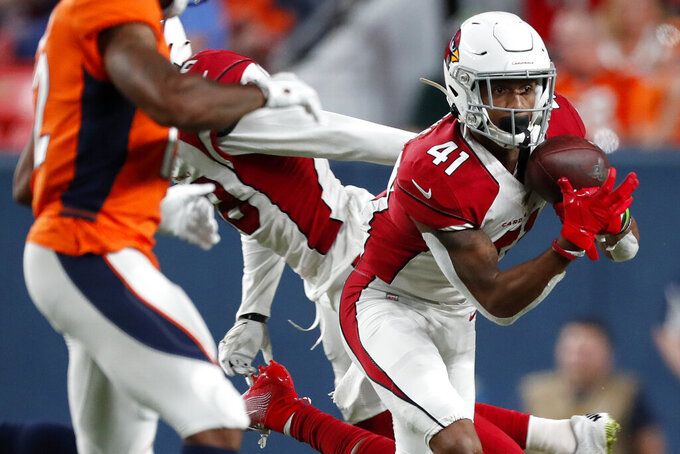 Arizona Cardinals defensive back Nate Brooks (41) intercepts a pass against the Denver Broncos during the first half of an NFL preseason football game, Thursday, Aug. 29, 2019, in Denver. (AP Photo/David Zalubowski)