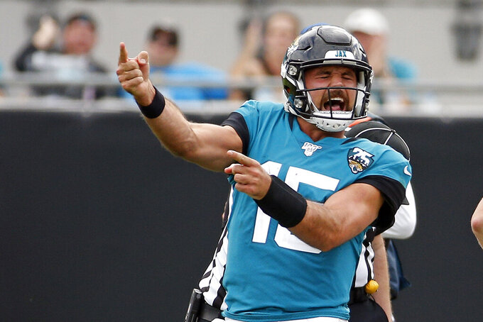 Jacksonville Jaguars quarterback Gardner Minshew II celebrates after running for a first down and drawing a penalty against the New York Jets during the second half of an NFL football game, Sunday, Oct. 27, 2019, in Jacksonville, Fla. (AP Photo/Stephen B. Morton)