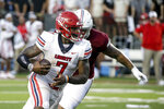 Liberty quarterback Malik Willis (7) carries the ball against Troy during the first half of an NCAA college football game Saturday, Sept. 11, 2021, in Troy, Ala. (AP Photo/Butch Dill)