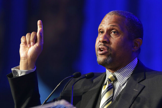 FILE - In this May 29, 2014 file photo, author and talk show host Tavis Smiley speaks at Book Expo America in New York.  A jury on Wednesday found that former talk show host Tavis Smiley violated the morals clause of his contract with the Public Broadcasting Service after allegations of workplace sexual misconduct, and must pay his former employer about $1.5 million. (AP Photo/Mark Lennihan, File)