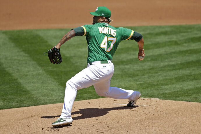 Oakland Athletics pitcher Frankie Montas works against the Houston Astros in the first inning of a baseball game Saturday, Aug. 8, 2020, in Oakland, Calif. (AP Photo/Ben Margot)