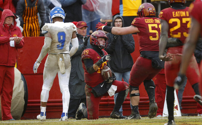 Iowa State quarterback Brock Purdy (15) celebrates with teammate Julian Good-Jones (51) after scoring on an 11-yard touchdown run during the first half of an NCAA college football game against Drake, Saturday, Dec. 1, 2018, in Ames, Iowa. Iowa State won 27-24. (AP Photo/Charlie Neibergall)