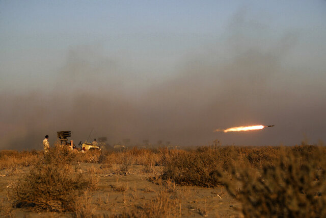 This photo released Tuesday, Jan. 19, 2021, by the Iranian Army, shows a missile being fired during a military drill. Iran's military kicked off a ground forces drill on Tuesday along the coast of the Gulf of Oman, state TV reported, the latest in a series of snap exercises that the country is holding amid escalating tensions over its nuclear program and Washington's pressure campaign against Tehran. (Iranian Army via AP)