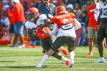Cleveland Browns quarterback Baker Mayfield (6) hands off to running back Kareem Hunt (27) during practice at the NFL football team's training facility Monday, Aug. 5, 2019, in Berea, Ohio. (AP Photo/Ron Schwane)