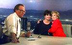 FILE - In this Dec. 12, 1997 file photo, Tina Sinatra, center, and Nancy Sinatra, right, daughters of the singer Frank Sinatra, joke around on CNN's Los Angeles set of