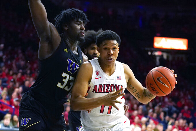 Arizona forward Ira Lee (11) drives on Washington forward Isaiah Stewart during the second half of an NCAA college basketball game Saturday, March 7, 2020, in Tucson, Ariz. Washington won 69-63. (AP Photo/Rick Scuteri)