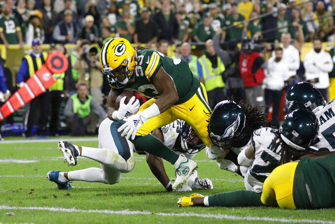 Green Bay Packers running back Aaron Jones dives into the end zone for a touchdown during the first half of the team's NFL football game against the Philadelphia Eagles on Thursday, Sept. 26, 2019, in Green Bay, Wis. (AP Photo/Jeffrey Phelps)