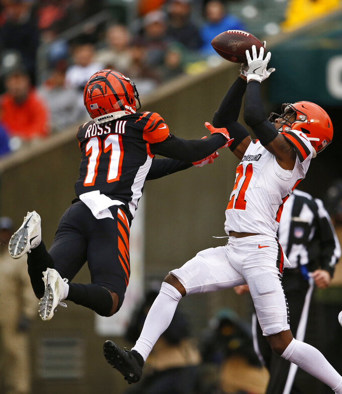 Cleveland Browns cornerback Denzel Ward (21) catches an interception against Cincinnati Bengals wide receiver John Ross (11) during the second half of an NFL football game, Sunday, Dec. 29, 2019, in Cincinnati. (AP Photo/Gary Landers)