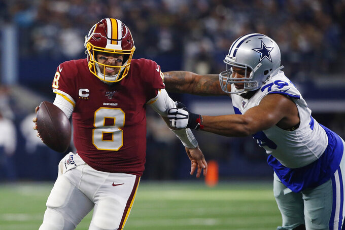 Washington Redskins quarterback Case Keenum (8) is pressured by Dallas Cowboys defensive end Michael Bennett (79) during the first half of an NFL football game in Arlington, Texas, Sunday, Dec. 15, 2019. (AP Photo/Ron Jenkins)