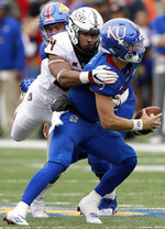 FILE - In this Saturday, Sept. 29, 2018, file photo, Kansas quarterback Carter Stanley (9) is sacked by Oklahoma State defensive end Jordan Brailford (94) during the second half of an NCAA college football game in Lawrence, Kan. Brailford is the Big 12 leader with seven sacks, twice as many as any other player. He had three last week against Kansas.  (AP Photo/Orlin Wagner, File)