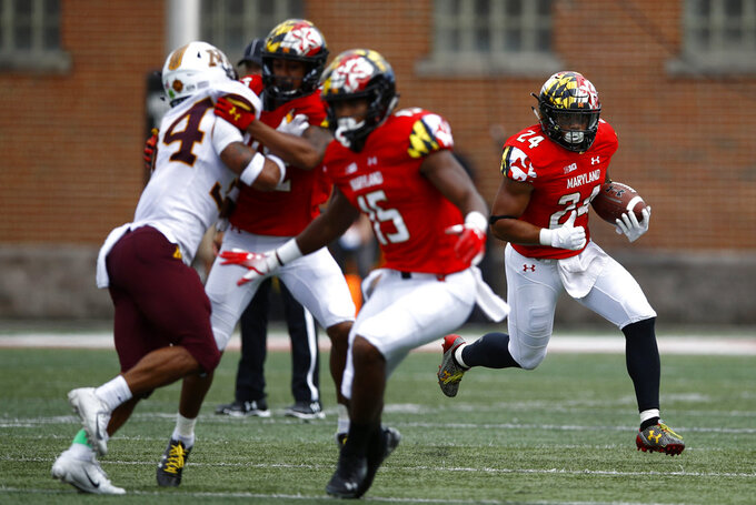 Maryland running back Ty Johnson, right, rushes the ball in the second half of an NCAA college football game against Minnesota, Saturday, Sept. 22, 2018, in College Park, Md. Maryland won 42-13. (AP Photo/Patrick Semansky)