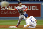 Washington Nationals second baseman Brian Dozier, top, completes a double play over Los Angeles Dodgers' Corey Seager after a ground ball from Chris Taylor during the fourth inning of a baseball game Thursday, May 9, 2019, in Los Angeles. (AP Photo/Marcio Jose Sanchez)