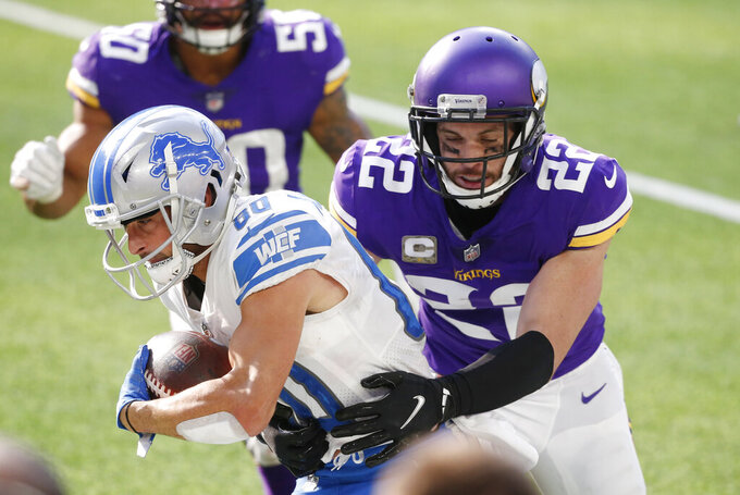 Detroit Lions wide receiver Danny Amendola (80) tries to break a tackle by Minnesota Vikings safety Harrison Smith (22) after catching a pass during the first half of an NFL football game, Sunday, Nov. 8, 2020, in Minneapolis. (AP Photo/Bruce Kluckhohn)