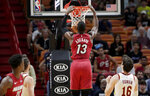 Miami Heat center Bam Adebayo (13) dunks over Cleveland Cavaliers forward Cedi Osman (16) during the first half of an NBA basketball game, Wednesday, Nov. 20, 2019, in Miami. (AP Photo/Lynne Sladky)