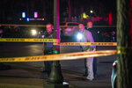 In this Wednesday, Sept. 18, 2019 photo, investigators walk through the scene of a homicide in St. Paul, Minn. (Renee Jones Schneider/Star Tribune via AP)