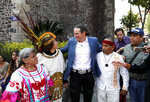 Italian Ascanio Pignatelli of the 16th generation descended from Hernan Cortes' daughter, poses for a picture with Aztec dancers in Mexico City, Friday, Nov. 8, 2019. Descendants of the Spanish conquistador Hernan Cortes and the Aztec emperor Moctezuma are meeting in Mexico City to mark the 500th anniversary of their forbearers' first encounter.  (AP Photo/Eduardo Verdugo)