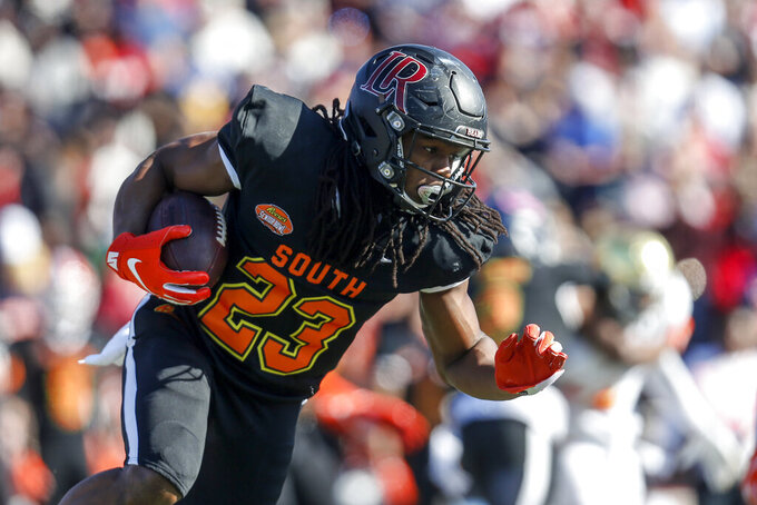 South safety Kyle Dugger of Lenoir Rhyne (23) carries the ball on a punt return during the first half of the Senior Bowl college football game Saturday, Jan. 25, 2020, in Mobile, Ala. (AP Photo/Butch Dill)