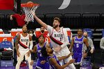 Portland Trail Blazers center Jusuf Nurkic, right, goes to the basket over Sacramento Kings forward Marvin Bagley III, foreground center, during the first quarter of an NBA basketball game in Sacramento, Calif., Wednesday, Jan. 13, 2021. (AP Photo/Rich Pedroncelli)