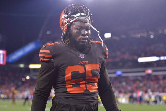File-This Nov. 14, 2019 file photo shows Cleveland Browns defensive tackle Larry Ogunjobi walking off the field after he was ejected late in the fourth quarter of an NFL football game against the Pittsburgh Steelers in Cleveland. The one-game NFL suspension for Ogunjobi for his role in the brawl with the Pittsburgh Steelers was upheld by an appeals officer. Ogunjobi shoved Pittsburgh quarterback Mason Rudolph to the ground moments after Cleveland teammate Myles Garrett swung a helmet and struck the Steelers QB in the head. Garrett was suspended indefinitely by the league for his alarming assault. His appeal was heard in New York on Wednesday, Nov. 20, 2019. (AP Photo/David Richard, File)