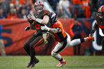 Cleveland Browns quarterback Baker Mayfield (6) is sacked by Denver Broncos defensive end Derek Wolfe (95) during the second half of NFL football game, Sunday, Nov. 3, 2019, in Denver. (AP Photo/David Zalubowski)