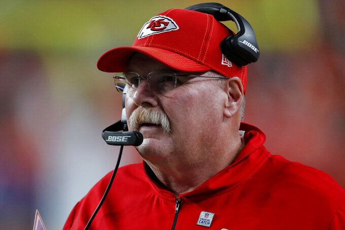 Kansas City Chiefs head coach Andy Reid watches his team the second half of an NFL football game against the Denver Broncos, Thursday, Oct. 17, 2019, in Denver. The Chiefs won 30-6 in Reid's 200th career win. (AP Photo/David Zalubowski)