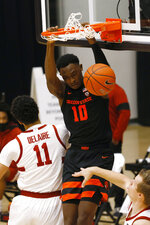 Oregon State forward Warith Alatishe (10) dunks in front of Stanford forward Jaiden Delaire (11) during the first half of an NCAA college basketball game in Stanford, Calif., Saturday, Feb. 27, 2021. (AP Photo/Josie Lepe)