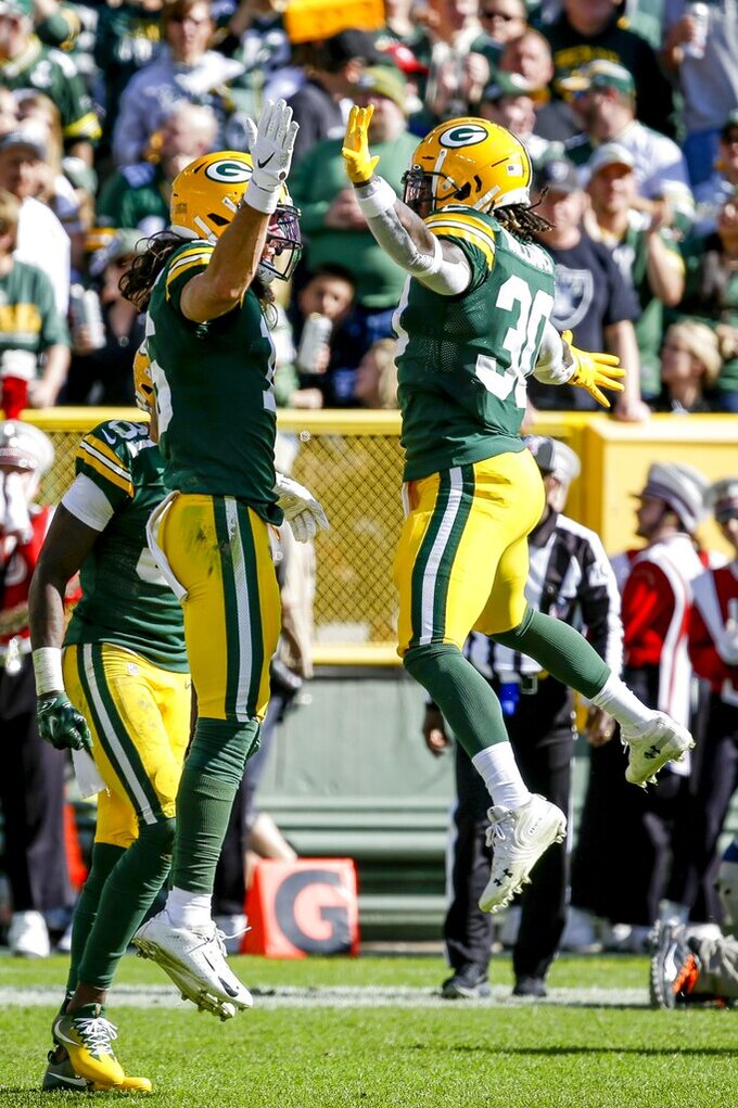 Green Bay Packers' Jake Kumerow celebrates his touchdown catch with Jamaal Williams (30) during the first half of an NFL football game against the Oakland Raiders Sunday, Oct. 20, 2019, in Green Bay, Wis. (AP Photo/Mike Roemer)