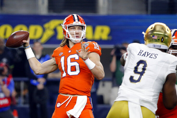 Clemson quarterback Trevor Lawrence (16) throws a pass under pressure from Notre Dame defensive lineman Daelin Hayes (9) in the first half of the NCAA Cotton Bowl semi-final playoff football game, Saturday, Dec. 29, 2018, in Arlington, Texas. (AP Photo/Michael Ainsworth)