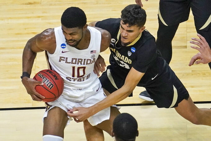 Colorado forward Tristan da Silva, right, fouls Florida State forward Malik Osborne (10) during the first half of a second-round game in the NCAA college basketball tournament at Farmers Coliseum in Indianapolis, Monday, March 22, 2021. (AP Photo/Charles Rex Arbogast)