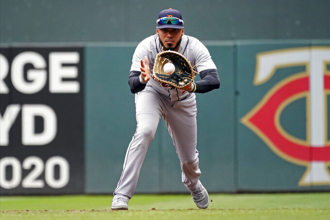 Detroit Tigers first baseman Harold Castro fields the ball as Minnesota Twins' Jorge Polanco grounds out in the first inning of a baseball game, Wednesday, July 28, 2021, in Minneapolis. (AP Photo/Jim Mone)