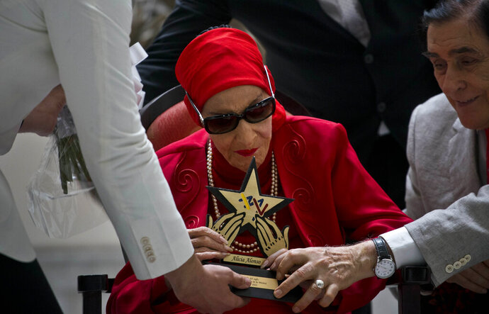 FILE - In this March 20, 2019 file photo, Cuba's Prima Ballerina Alicia Alonso receives the Star of the Century award from the Latin Music Institute in recognition of her contribution to ballet and culture, during a ceremony in Havana, Cuba. Cuba's national ballet has reported that Alonso has died on Thursday, Oct. 17, 2019. (AP Photo/Ramon Espinosa, File)