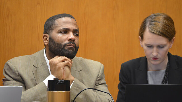 Defendant Willie Cory Godbolt, seated left of one of his attorneys, Katherine Poor, listens to his 12-year-old daughter's testimony on the third day of Godbolt's capital murder trial at the Pike County Courthouse in Magnolia, Miss. Godbolt, 37, is on trial, for the May 2017 shooting deaths of eight people in Brookhaven. (Donna Campbell/The Daily Leader via AP, Pool)