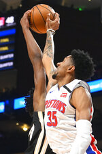 Detroit Pistons forward Christian Wood (35) blocks a shot by Atlanta Hawks forward Cam Reddish during the first half of an NBA basketball game Saturday, Jan. 18, 2020, in Atlanta. (AP Photo/John Amis)