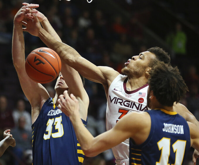 Virginia Tech's Wabissa Bede (3) battles for a rebound with Chattanooga's Stefan Kenic (33) and Rod Johnson (11) in the first half of an NCAA college basketball game, Wednesday, Dec. 11, 2019, in Blacksburg, Va. (Matt Gentry/The Roanoke Times via AP)