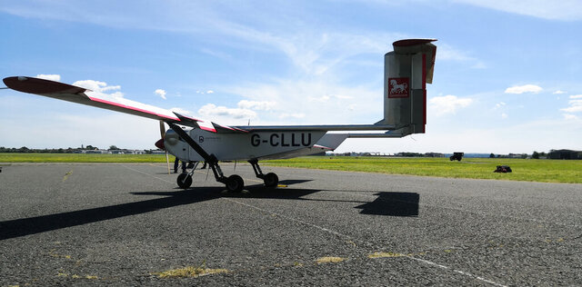 """The """"Wingracers ULTRA"""" drone parked by the runway at Solent Airport, in Lee-on-the-Solent, England, Tuesday, May 12, 2020. Britain is testing the use of a car-sized drone to deliver medical supplies more quickly to hospitals and help ease pressure on the country's health system during the new coronavirus crisis. (AP Photo/James Brooks)"""