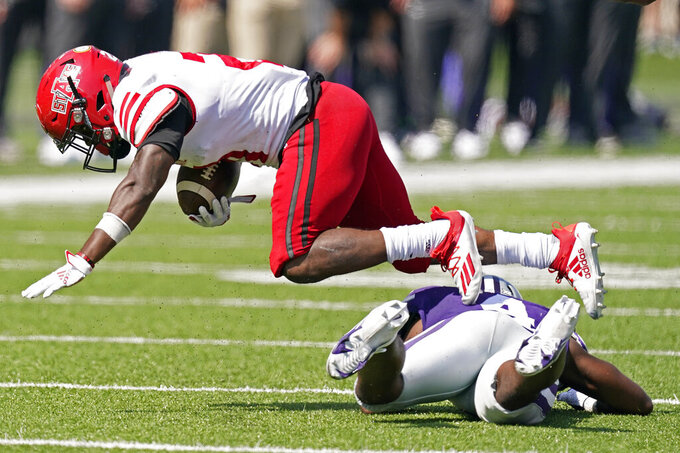 Arkansas State running back Jamal Jones (21) leaps over Kansas State defensive back Wayne Jones (4) during the second half of an NCAA college football game Saturday, Sept. 12, 2020, in Manhattan, Kan. Jones was injured on the play and came out of the game. Arkansas State won 35-31. (AP Photo/Charlie Riedel)