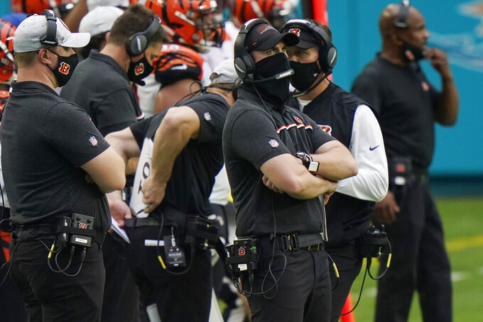 Cincinnati Bengals head coach Zac Taylor watched his team during the second half of an NFL football game against the Miami Dolphins, Sunday, Dec. 6, 2020, in Miami Gardens, Fla. (AP Photo/Lynne Sladky)