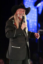 FILE - Dean Dillon accepts the Icon Award at the BMI Country Awards in Nashville, Tenn. on Nov. 5, 2013.  Dillon, along with Hank Williams, Jr., and Marty Stuart, will be inducted into the Country Music Hall of Fame.  (AP Photo/Mark Humphrey)