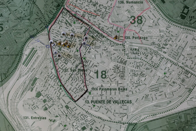 Detail of a map showing the southern neighbourhood of Vallecas in Madrid, Spain, Wednesday, Sept. 2, 2020. Authorities in Madrid, the European capital experiencing the worst second-wave outbreak, are introducing new curbs on social gatherings starting Monday. The restrictions coincide with the opening of most schools, which is perceived as a potential tipping point in the battle against the virus. The focus is especially on areas like San Diego, a culturally diverse neighborhood of narrow streets and small apartments where many residents continued commuting to work over the summer, often to do manual labor and unstable jobs. (AP Photo/Bernat Armangue)