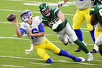 Los Angeles Rams quarterback Jared Goff throws the ball away as he is tackled by New York Jets defensive end Henry Anderson during the second half of an NFL football game Sunday, Dec. 20, 2020, in Inglewood, Calif. (AP Photo/Jae C. Hong)