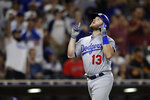 Los Angeles Dodgers' Max Muncy reacts after hitting a home run during the ninth inning of a baseball game against the San Diego Padres on Tuesday, July 10, 2018, in San Diego. The Padres won 4-1. (AP Photo/Gregory Bull)