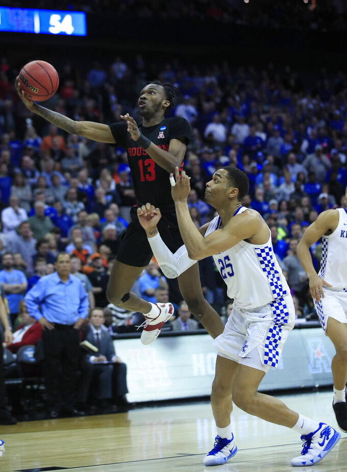 Houston's DeJon Jarreau (13) heads to the basket past Kentucky's PJ Washington (25) during the second half of a men's NCAA tournament college basketball Midwest Regional semifinal game Friday, March 29, 2019, in Kansas City, Mo. (AP Photo/Orlin Wagner)