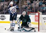 San Jose Sharks goaltender Martin Jones (31) blocks a shot from Winnipeg Jets right wing Blake Wheeler (26) during the second period of an NHL hockey game in San Jose, Calif., Friday, Nov. 1, 2019. (AP Photo/Tony Avelar)