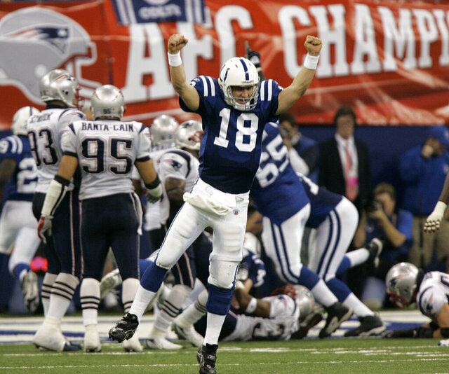 FILE - In this Jan. 21, 2007, file photo, Indianapolis Colts quarterback Peyton Manning (18) celebrates running back Joseph Addai's 3-yard touchdown run in the fourth quarter of the AFC Championship football game against the New England Patriots in Indianapolis. Peyton Manning, Charles Woodson, Jared Allen and Calvin Johnson are first-year eligible players to make the list of 25 semifinalists for the Pro Football Hall of Fame's class of 2021. (AP Photo/Amy Sancetta, File)