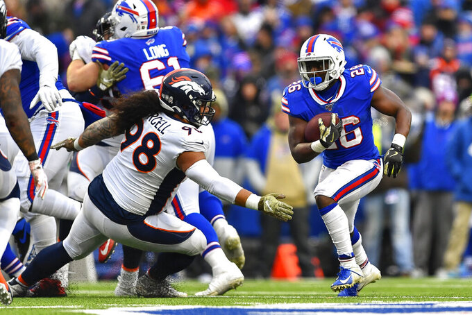 Buffalo Bills running back Devin Singletary (26) runs the ball against the Denver Broncos during the fourth quarter of an NFL football game, Sunday, Nov. 24, 2019, in Orchard Park, N.Y. (AP Photo/Adrian Kraus)