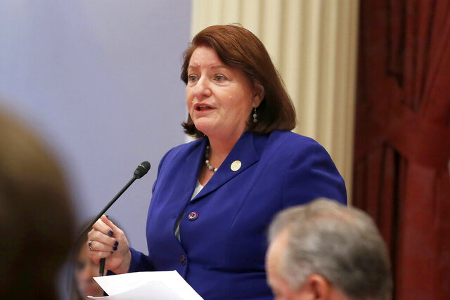FILE - In this Sept. 12, 2019, file photo, California state Senate President Pro Tem Toni Atkins of San Diego speaks on the floor of the Senate in Sacramento, Calif. The California Senate's plan to cover a projected budget deficit rejects Gov. Gavin Newsom's proposed cuts to public education and health care programs. Newsom's plan would cut funding for public schools by about $8 billion. The Senate's plan would restore $2.7 billion of those cuts, the rest being deferred to future years. (AP Photo/Rich Pedroncelli, File)