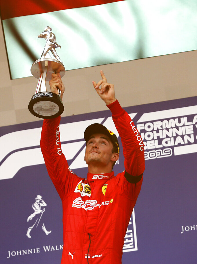 Ferrari driver Charles Leclerc of Monaco lifts the trophy after finishing first in the Belgian Formula One Grand Prix in Spa-Francorchamps, Belgium, Sunday, Sept. 1, 2019. Mercedes driver Lewis Hamilton of Britain placed second and Mercedes driver Valtteri Bottas of Finland placed third. (AP Photo/Francisco Seco)
